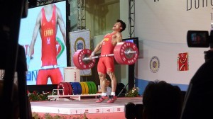 Weight Training For Wrestling Triple Extension Pic- an image of an Olympic lifter performing the Snatch.  The picture was taken at the peak of triple extension.