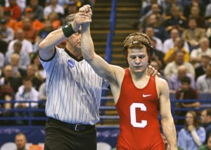 Troy Nickerson getting his hand raised after winning the 2009 NCAA title