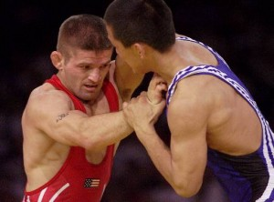 An image from the Olympics of 2 Greco-Roman wrestlers hand fighting for position.