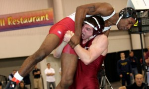 Wrestling Exercises post- an image of J.P. O'Connor lifting Darrion Caldwell off the mat with a single leg takedown.