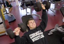 strength and conditioning for wrestling- a picture of troy nickerson performing a dumbbell press