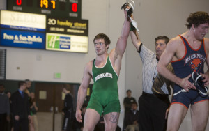 Binghamton University wrestler, Cody Reed, getting his hand raised after winning a match over a Bucknell wrestler.