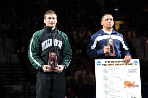 A picture of Donnie Vinson standing in the 3rd place spot on the NCAA wrestling championships podium.