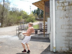 Kyle Dake lifting and carrying a keg as part of his program back when he was a senior in high school.